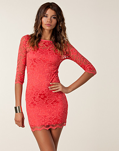 In this dress the tiers are made to a knit lace, two different laces, while soft and comfortable, I don't know how they will hold up in wear. I love the color, coral/peach, which is so popular. The fit is perfect and I love the slimming effect.