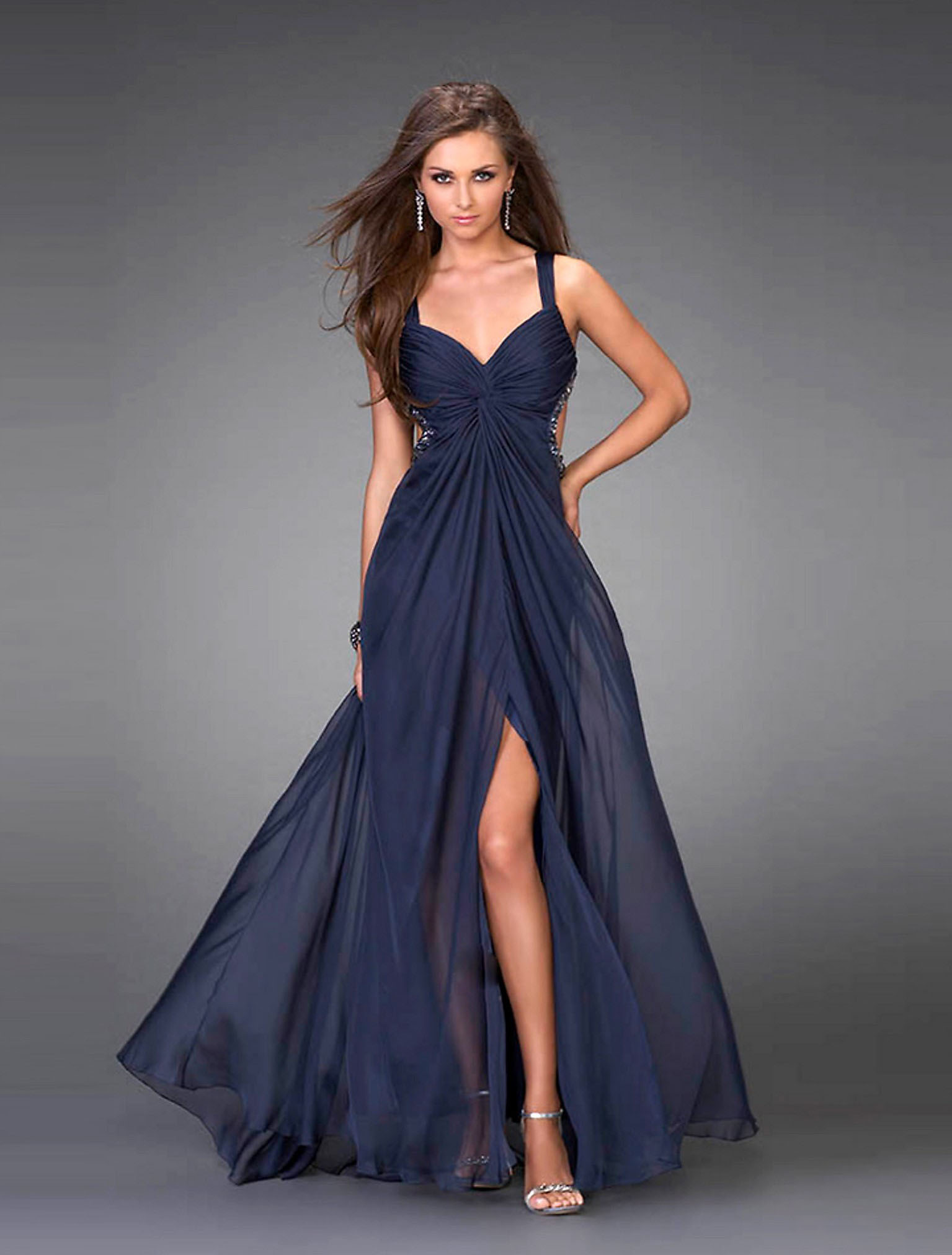 A cobalt blue dress is a total showstopper for so many reasons. It's less-expected than a red or black dress. The cool, vibrant color is strong without being over-the-top.