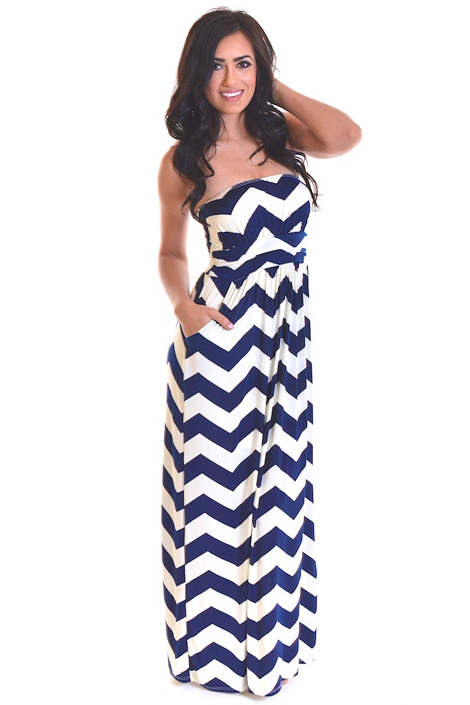 Kat Tanita of With Love From Kat wears a navy and white chevron print DVF dress with Sam Edelman flat sandals and a vintage clutch in New York City.