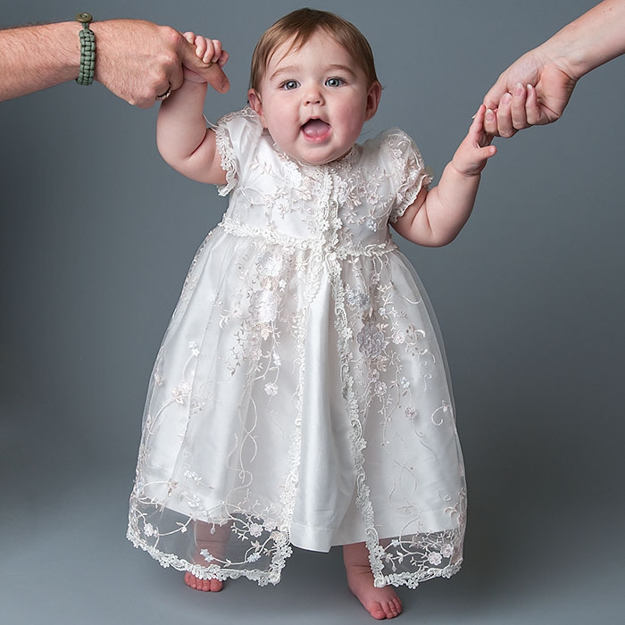 Baby girls' christening gowns, dresses, and outfits come in an array of styles as well as colors. Whether you're looking for split front dresses with inverted pleats, pick-up hems, tiered ruffles, crushed rosette overlays, or even detailed embroidery, you can find it all right here.